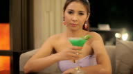 woman having a cocktail video