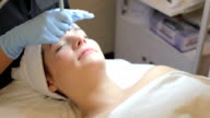Woman Having Dermo Abrasion Cosmetic Treatment At Spa video