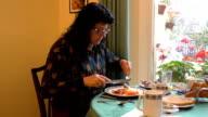 Woman having English breakfast video