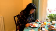 Woman having English breakfast video