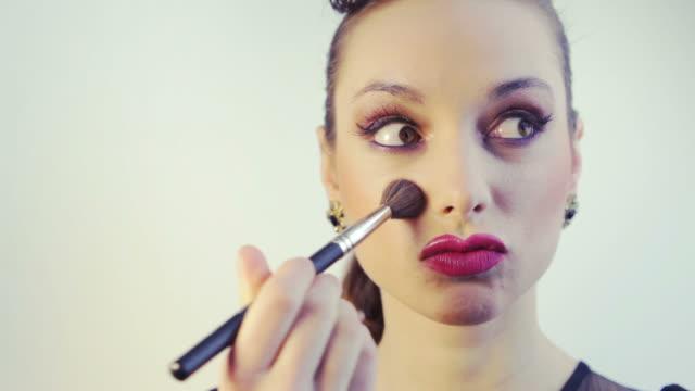 Woman having fun applying makeup video