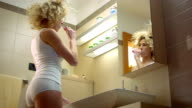 Woman Having Fun Brushing Teeth video
