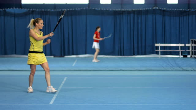 LS Woman Having Fun Playing Indoor Tennis video