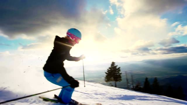 SLO MO Woman having fun skiing down ski slope video