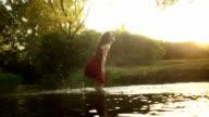 Woman having fun splashing water video