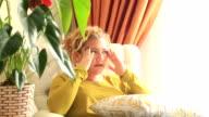 Woman having headache migraine video