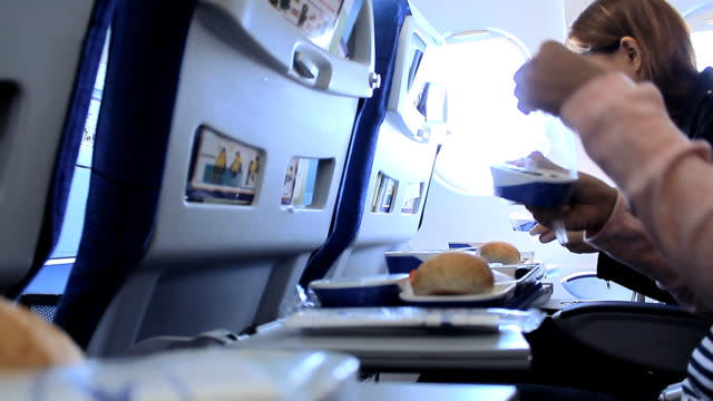 Woman Having lunch in airplane video