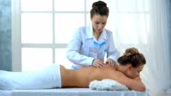 Woman having massage of body in the spa salon. video