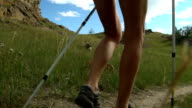 Woman hiking around mountains at summer time. video