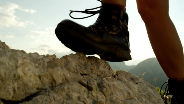 CLOSE UP: Woman hiking rocky mountains in comfortable new mountaineering boots video