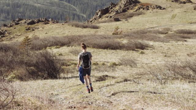 Woman hiking through high plateau video