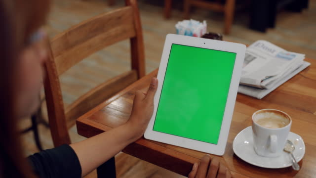 Woman hold Green screen Digital tablet video