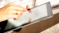 Woman holding a digital tablet video