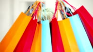 Woman holding a few shopping bag video