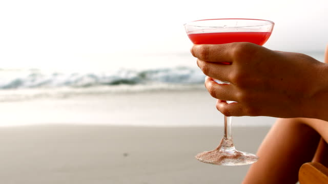 Woman holding cocktail video