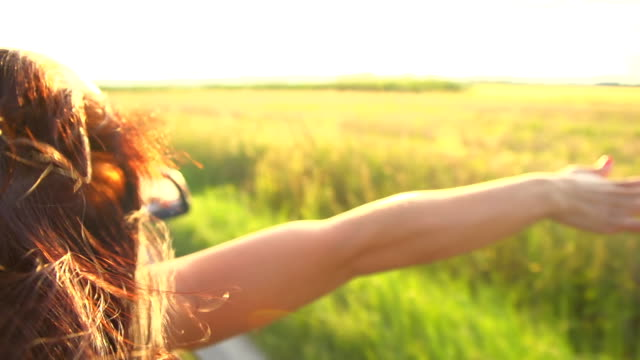 HD SUPER SLOW-MOTION: Woman Holding Her Arms Out Of Convertible video