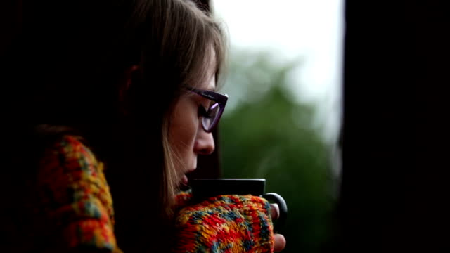 Woman holding mug of coffee. video