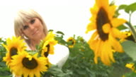 HD DOLLY: Woman Holding Out Sunflowers video