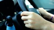 Woman holding steering wheel Driving car video