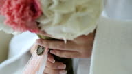 Woman holds beautiful floral bouquet in her delicate hands video