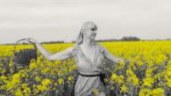 HD SLOW MOTION: Woman Hopping Through Canola Field video