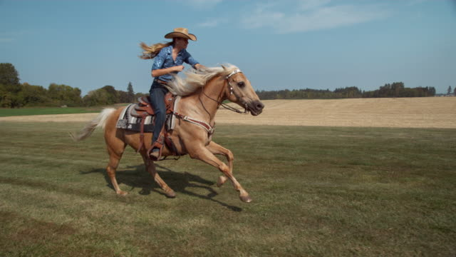 Woman horseback riding in super slow motion video