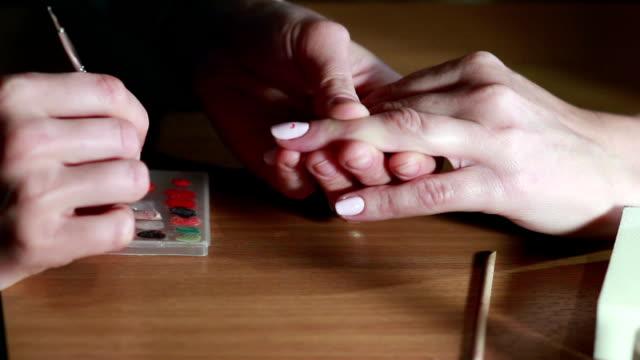 Woman in a Beauty Salon receiving a manicure video