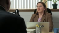 Woman in a business meeting video
