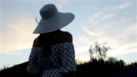 A woman in a hat in a windy weather. video