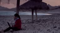Woman in a hurricane day at the beach video