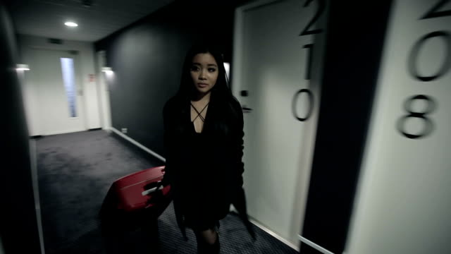 Woman in a long corridor of the hotel with suitcase video