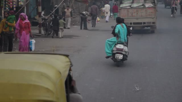 Woman in a Motorcyle and Tuk-tuk. video