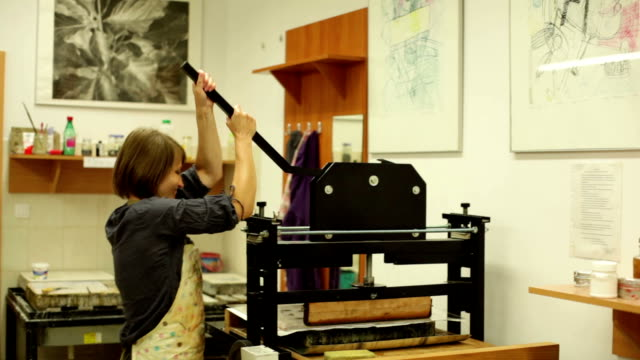 woman in a printing shop video