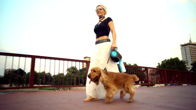 Woman in a walk with her puppy video