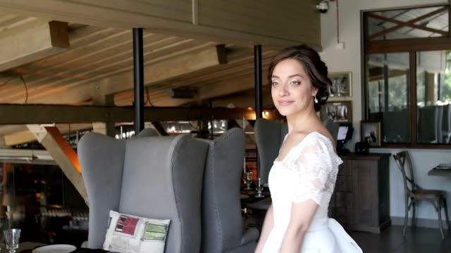 woman in a wedding dress is spinning . video
