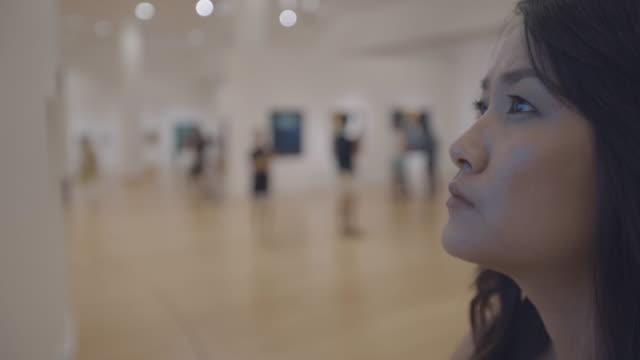 woman in art gallery video