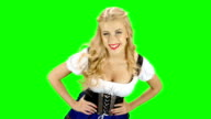 Woman in bavarian costume is in the room and touches the hair. Green screen video