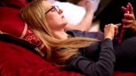 Woman In Bed With Eletronic Tablet video