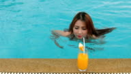 Woman in bikini with cocktail video
