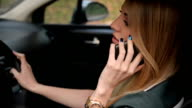 Woman in car talking on the phone video