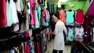Woman in clothing store video