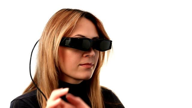 Woman in cyberspace with video eyewear video