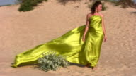 woman in fabric on sand video