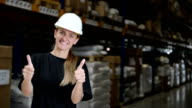 Woman in factory with thumbs up video