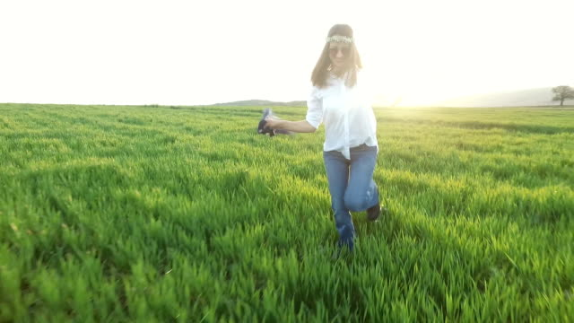Woman in field enjoying the nature video