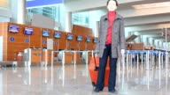 Woman in hall of airport video