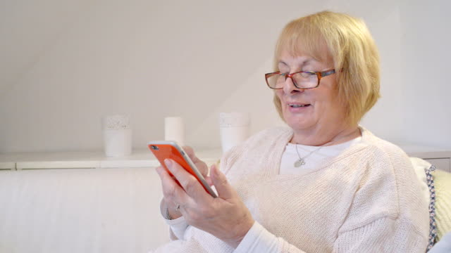 woman in her 70s with smart phone video