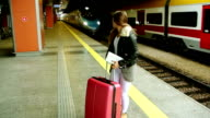 woman in hurry at train station video