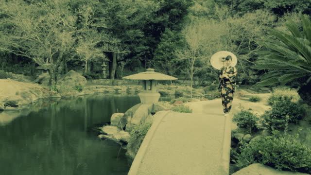 HD: Woman in kimono with umbrella (video) video