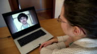 Woman In Kitchen Using Laptop - Online Chat with Doctor on Screen video